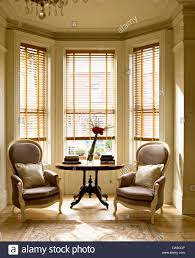 window chair furniture. Living Room With Pair Of Victorian Style Chairs On Either Side Antique Table In Bay Window Wooden Venetian Blind Chair Furniture R