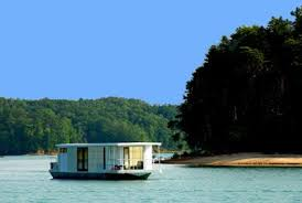this metroship luxury houseboat by ballinger co is being offered as one of