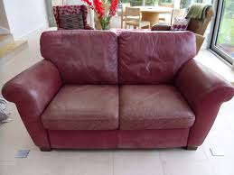 worn red leather sofa treated and colour fully red before