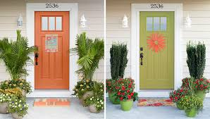 decorated entry doors with potted plants
