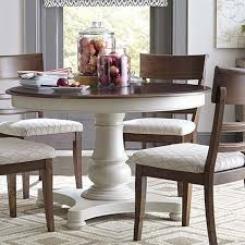 pick the perfect dining room table for your home with the customizable 48 round pedestal table by bett furniture choose your finish to this clic