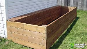 can i build a raised garden bed next to