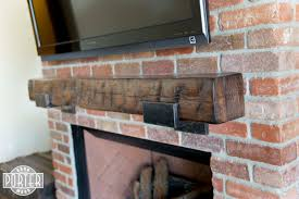 hand hewn pine mantel with custom steel brackets porter