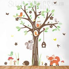 the woodland forest wall art sticker has forest animals playing around a large oak tree with
