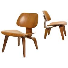 eames rare matched pair of walnut lcw lounge chairs for sale at