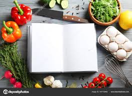 Open Notebook And Vegetables On Kitchen Table Cooking Classes