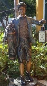 bronze golf caddy with lantern golf garden statue