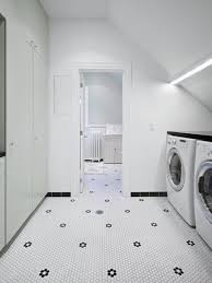 Inspiration for a mid-sized scandinavian galley porcelain floor and white  floor dedicated laundry room