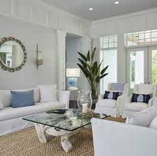coastal blue and white slipcover living room with striped rug