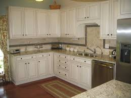 white paint wooden l shaped kitchen cabinet featuring grey granite countertop design together oil rubbed bronze