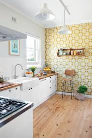 whimsy yellow and cream geometric wallpaper for an accent wall in the kitchen