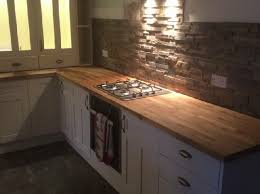 Models Kitchen Stone Wall Tiles With An Ivory And Oak Throughout Ideas