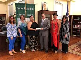 the pan american round table of laredo presents a donation check to lcc