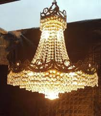 spectacular chandelier lamp of rock crystal teardrops and carved brass crown 20th century