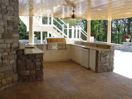 outdoor kitchen under a deck