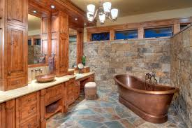 this elegant bathroom has a copper freestanding tub and a copper sink