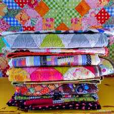 Image result for pile of quilts