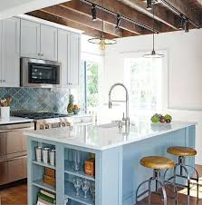 blue quartz countertops transitional kitchen displaying a sky blue kitchen island with shelves topped with white