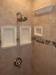 daltile cv 10 series tile with custom architectural niches and ceramic crown moulding by me shower foot rest located at 18 height chair height recessed