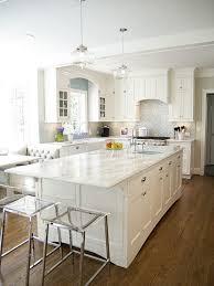all white kitchen decor with a silver backsplash and white quartz counters for a serene