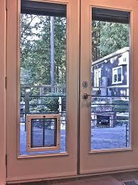 image of screen patio door with dog door