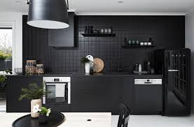 It stretches all throughout the home, even in the kitchen and bathroom.  Simply obsessed with this minimal black kitchen.