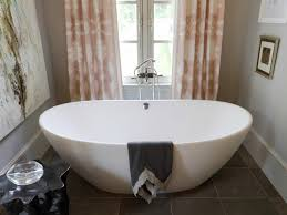 cool drop in soaker tub bathroom minimalist decor with towel and curtains  and side table and