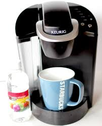 Fill the tank with a mixture of water and vinegar in equal parts. How To Clean Your Keurig Coffee Maker With Vinegar The Frugal Girls