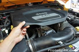 2012 jeep jk wrangler 3 6l pentastar engine oil change write up your engine cover is just snapped in place and to remove it simply grab and lift it up as shown