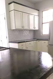 Concrete wax on wall tile kitchen