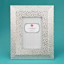 our frame is made from pu and features a wide border with a beveled edge the frame is decorated with an embossed silver material that will bring a
