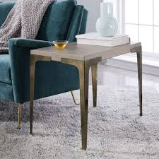 west elm brass and concrete sqaure side table beside sofa