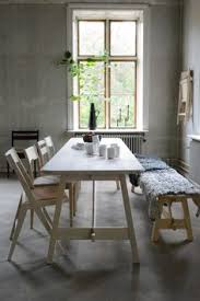 modern rustic kitchen with natural wood set against stony greys the grey sheepskin brings a little cozy softness to offset the rooms predominantly straight