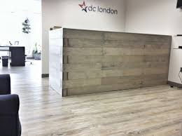 custom reception desk for a dc based political consulting firm made from maple and oxidized finish