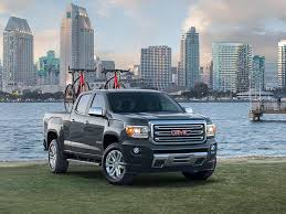 2018 gmc lifted trucks. contemporary 2018 image of the 2018 gmc canyon small pickup truck parked in front a beach  with to gmc lifted trucks p