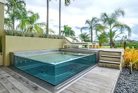 elevated swimming pool with glass walls see through pools reveal a