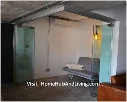 singapore designer make over a urban down town apartment cleverly selected frameless door system for creative co space flexible glass room for study