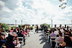 a wedding ceremony on the water at the battery park gardens in lower manhattan