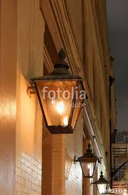 new orleans french quarter gas lights night street view with glowing real gas lanterns on