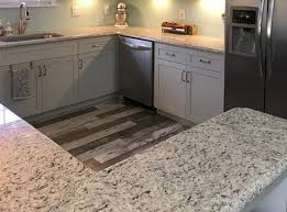 leblon slabs have a well balanced black white gray composition the effect is one that works with any kitchen hues from dark to light so it s no
