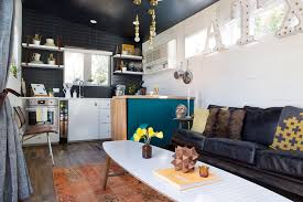 a compact yet efficient kitchen and living area comprises one of two connected trailers in kim