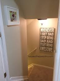 i hemmed and hawed for months over where to hang it and finally decided on the stair well to the basement you can see it from the foyer when looking down  on hang heavy wall art with how to hang heavy unlevel artwork easily house of hepworths