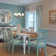dining room mid sized beach style um tone wood floor dining room idea in