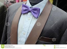 Purple Tie Light Blue Shirt Suit With Purple Bow Tie On Headless Mannequins Stock Photo