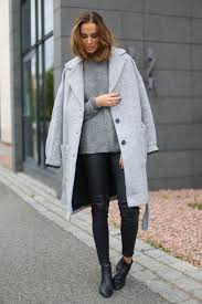 benedichte pairs leather trousers with a grey knit pullover and a matching boyfriend coat jacket