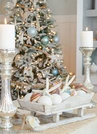 Coastal Christmas Tree with rope as garland, distressed wooden sea  ornaments, blue netting ornament