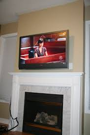 diy installing 46 inches lcd tv above the fireplace and patching the niche