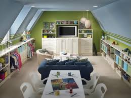 children playroom in loft with a lot of place to store the toys ...