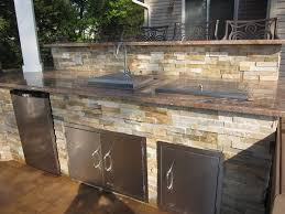 patio outdoor stone kitchen bar: hamptons project outdoor kitchen with dual bar top featuring outdoor fridge sink and access doors granite countertop veneered with east west stone