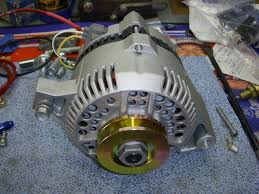 g alternator the ford torino page forum these are both large case 130 amp 3g s notice 2 holes per window